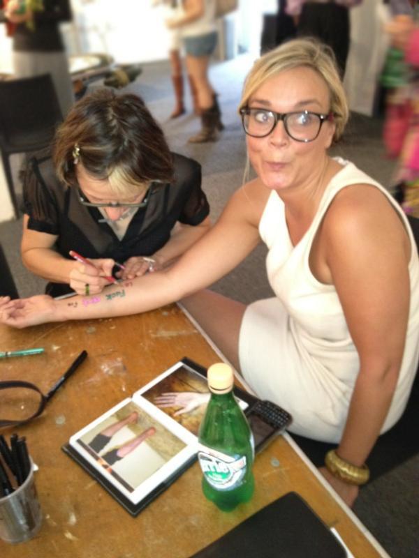 Natascha pen tattoos Hilary at Pulse Miami 2011