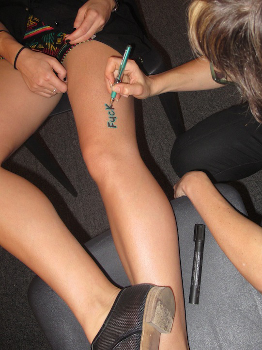 Natascha pen tattoos Nicole at Pulse Miami 2011