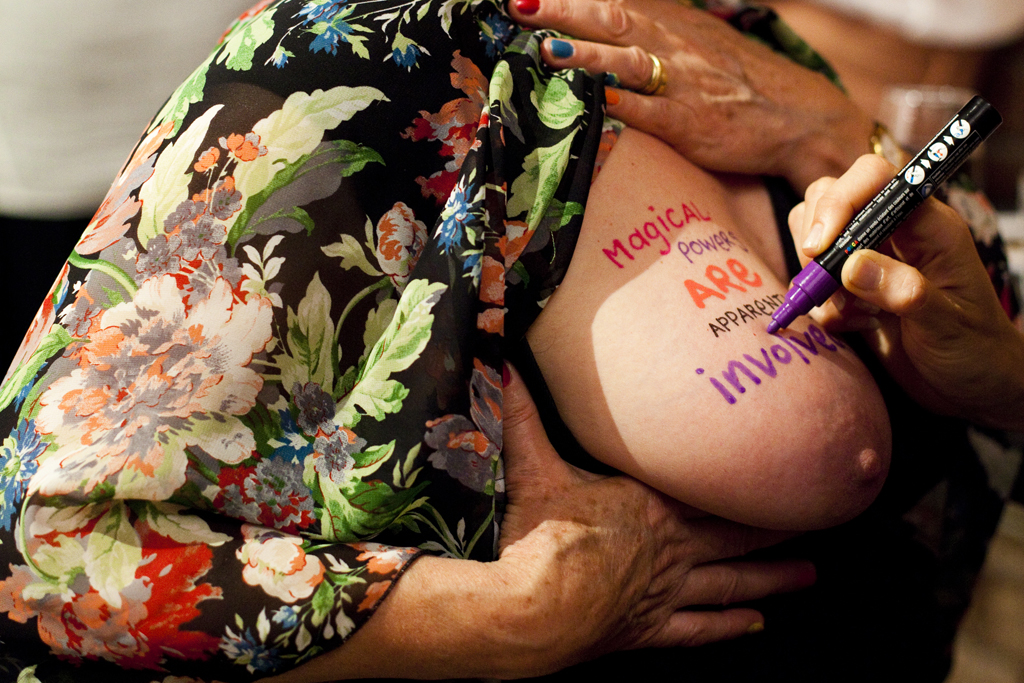 Natascha pen tattoos Anne during Agent Provocateur at Anna Pappas Gallery, Melbourne 2012, photo by Kim Liddle