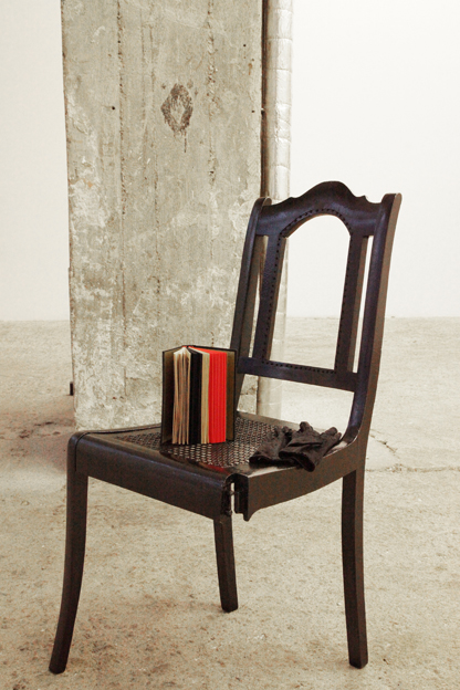 """Installation view, """"Fly"""", 300p hand-bound artist book, satin gloves, remodelled chair, dimensions variable, at Wagner+Partner Berlin, 2012"""