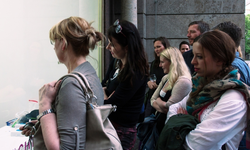 Viewers watch Natascha Stellmach's inkless tattoo happening at Wagner+Partner Berlin, 2013, photo by Oli Parzer