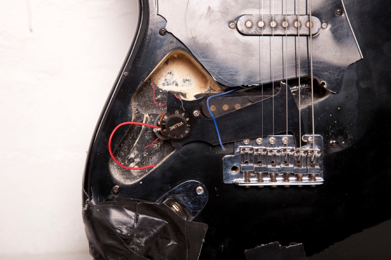Commodity, (detail), 2009, smashed left-handed 1980s guitar and amp lead, 100 x 33 x 4 cm