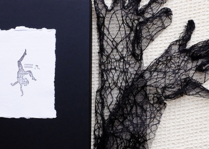Natascha Stellmach, The Book of Back (detail), offset printing on paper, thread, photograph, DVD, linen, box, faux grass, gloves, limited ed. 123, 2007