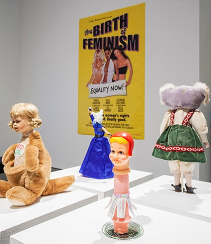 Detail, Worry Dolls installed at MACBA for PUNK, 2016 (Background poster by Guerilla Girls, 2001)